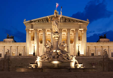 Austrian Parliament in Vienna at night, historically building at the ring road photo