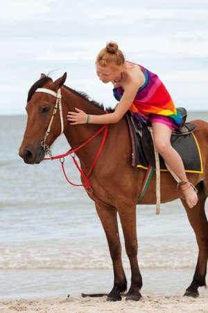 Horse riding on the beach photo