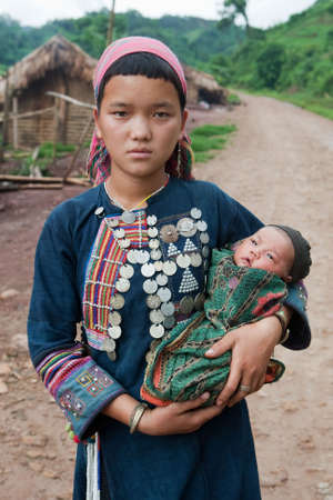 young hill tribe mother with baby photo