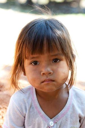 poor child: cute asian girl