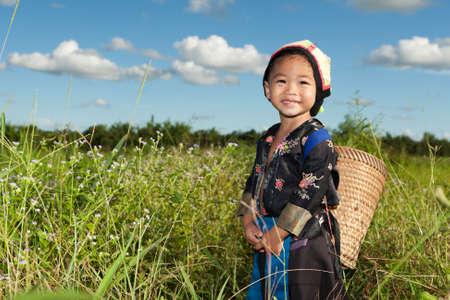 asian hmong girl on rice paddy Standard-Bild