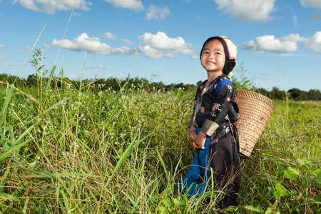 asian hmong girl on rice paddy photo