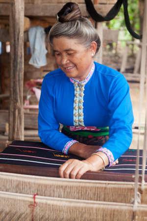 loom: Asian woman with loom
