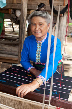 Asian woman with loom Stock Photo - 10621256