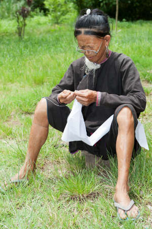 old woman sewing Stock Photo - 10698248