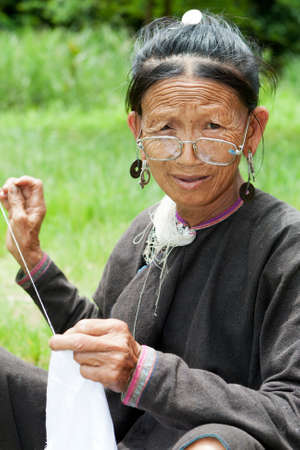 old woman sewing photo