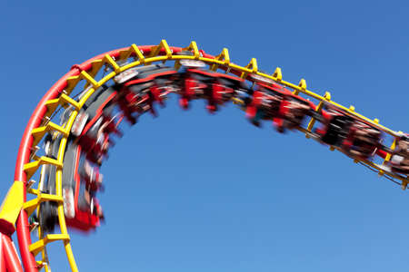 rollercoaster: rollercoaster against blue sky Stock Photo
