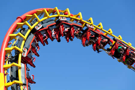 rollercoaster against blue sky Stock Photo