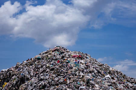 landfill: Landfill with blue sky and cumulus clouds