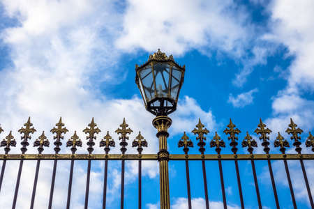 Historical fence with lantern Stock Photo