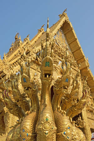 Wat Sripanton in Nan, Thailand, golden temple with dragons in front Stock Photo