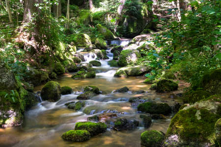mountain stream with blurred motion of waterfall