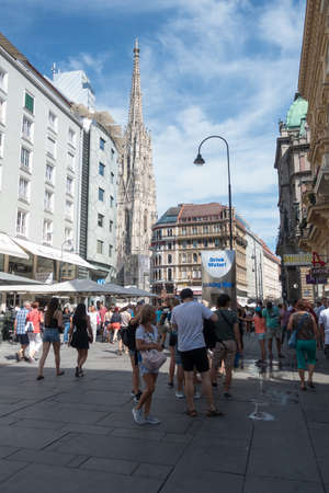 Vienna, Austria - July 31, 2017: Stephansplatz in Central Vienna with famous St. Stephens Cathedral. Tourists are walking around and enjoy the points of interest on a sunny day Redakční