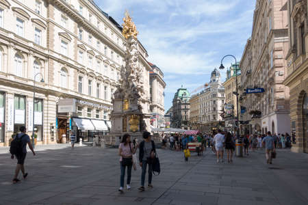 Vienna, Austria - July 31, 2017: The Street Am Graben in Central Vienna with the Pestsäule. Tourists are walking around and enjoy the points of interest on a sunny day