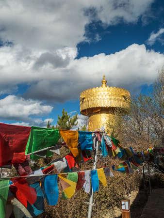 Giant Tibetian Praying Wheel, golden architecture in Shangri La, Yunnan, China