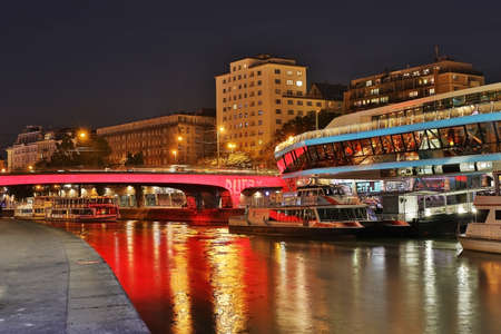 innere: Vienna, Austria - October 13,2013: danube canal at Schwedenplatz in downtown of Vienna is a popular promenade to relax and pier for ships