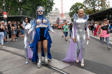 Vienna, Austria - June 16, 2018: Participants walk on the vienna Ring Strasse for Love Respect and Solidarity. Visitors watch the hustle and bustle