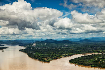 Mekong River At Nong Khai In Thailand, high angle view of landscape with cumulus clouds 免版税图像