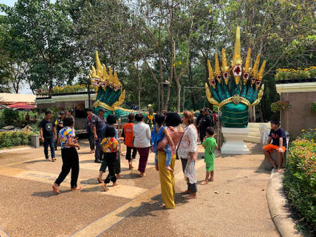 Kham Chanot, Thailand - April 10, 2019: Thai people and foreigners visit the famous buddhist place Kham chanot for praying and hope for good luck Editorial
