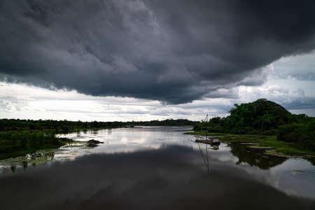Rain Cloud Reflection Lake, landscape at dusk with dark cumulus cloud