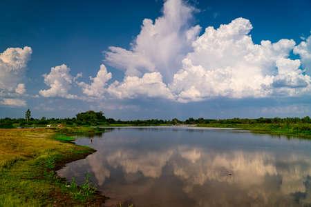 Landscape With Idyllic Lake, nature in summer with cumulus clouds Standard-Bild