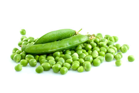 Pile of green peas and pair of pods isolated on the white background Stock Photo