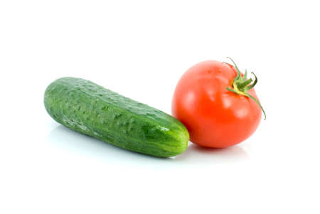 Red tomato and green cucumber isolated on the white background Stock Photo - 3232041