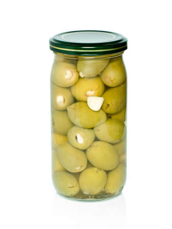 conserved: Olives with garlic conserved in glass jar isolated on the white background Stock Photo
