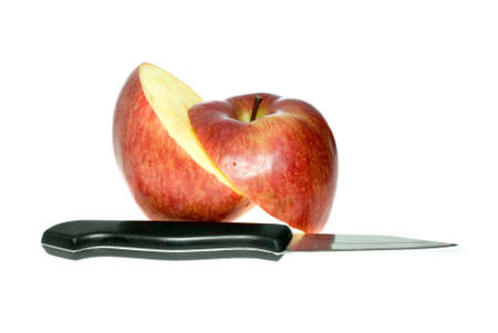 Sliced red apple and knife isolated on the white background photo