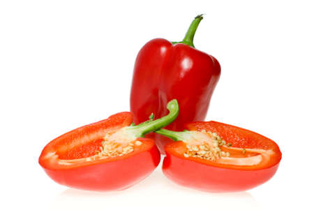 Whole red sweet pepper and two halves isolated on the white background photo