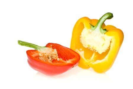 Half of red and yellow sweet peppers isolated on the white background photo