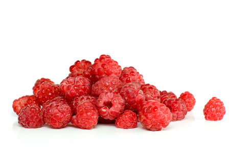 Red ripe raspberry pile isolated on the white background