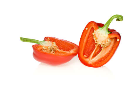 Two halves of red sweet pepper isolated on the white background photo