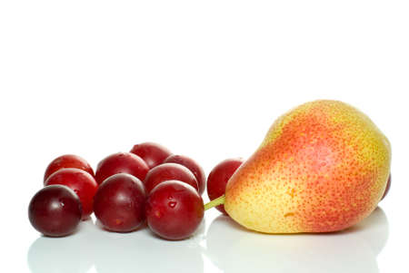alycha: Yellow-red pear and some cherry plums isolated on the white background Stock Photo