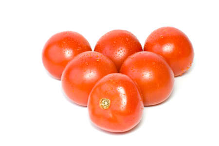 Six tomatoes isolated on the white background photo