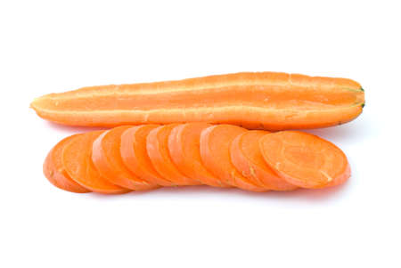 Half of ripe fresh long carrot and some slices isolated on the white background photo