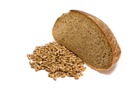 thrashed: Barley grains and piece of bread isolated on the white background