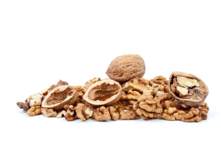 nutshells: Whole and cracked walnuts with nutshells over kernels isolated on the white background
