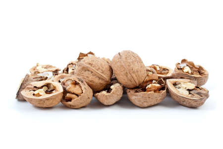shelled: Cracked and whole walnuts isolated on the white background Stock Photo