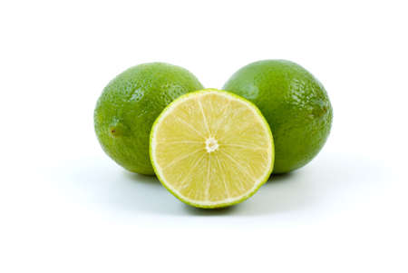 Limes. Whole and half isolated on the white background