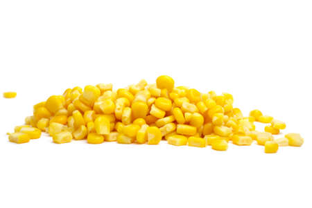 Pile of yellow corn grains isolated on the white background Stock Photo
