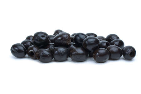 pitted: Some pitted black olives isolated on the white background