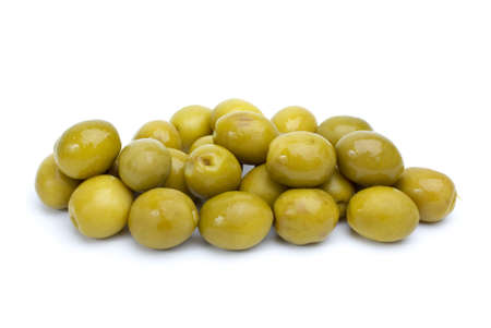 conserved: Some green olives with pits isolated on the white background