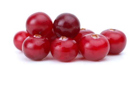 Close-up shot of few cranberries isolated on the white background Stock Photo
