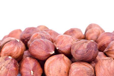 Some hazelnuts isolated on the white background Stock Photo - 4320230
