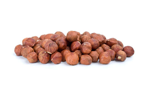 shelled: Small pile of hazelnuts isolated on the white background