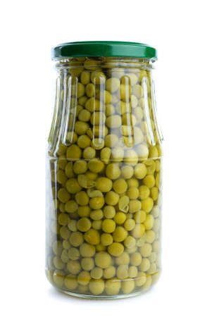 conserved: Glass jar with conserved green peas isolated on the white background