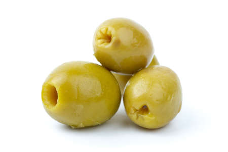 pitted: Three pitted marinated green olives close-up isolated on the white background