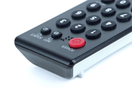 poweron: Remote control unit close-up. isolated on the white background (Focused on Power-on button)