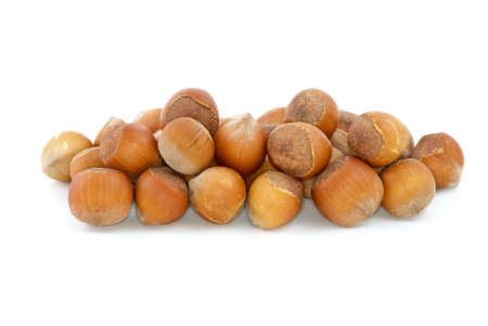 avellan: Small pile of hazelnuts isolated on the white background